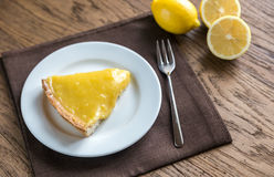 Slice of lemon tart on the plate Royalty Free Stock Photo