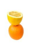 Slice lemon top on the orange. Stock Image