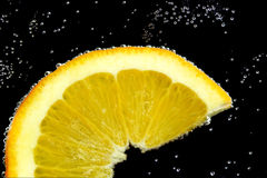Slice lemon in water Royalty Free Stock Photography