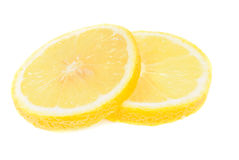 Slice of lemon on white Royalty Free Stock Image
