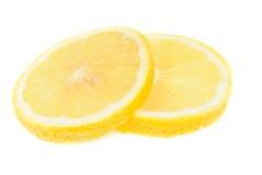 Slice of lemon on white Royalty Free Stock Image