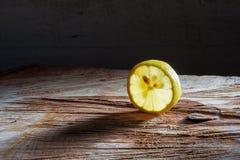 Slice of lemon on wood Royalty Free Stock Images