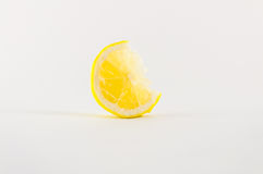 Slice of lemons. Slice of fresh lemon yellow on white background Royalty Free Stock Images