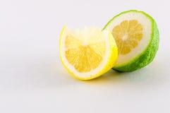 Slice of lemons. Slice of fresh lemons yellow and green on white background Stock Photos