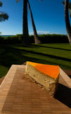 Slice of lilikoi cheesecake on a beautiful Hawaiian day. Slice of lilikoi cheesecake by the poolside royalty free stock photo