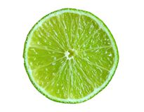 Slice of lime. Isolated on white background Stock Images