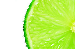 Slice of lime with bubbles. On white backgrounds Royalty Free Stock Photo