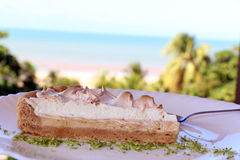 Slice of lime cake with ocean view Royalty Free Stock Images