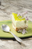 Slice of lime cheesecake decorated with mint flowers, blurred background Stock Photos