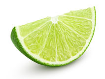 Slice of lime citrus fruit  on white Royalty Free Stock Photos