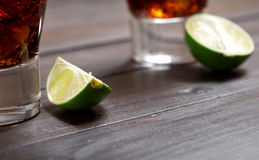 Slice of lime with a cocktail rum and cola Royalty Free Stock Image
