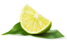 Slice of lime with leaves Stock Photos