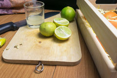 Slice the lime on wooden board Royalty Free Stock Photography