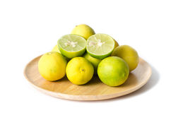 Slice lime on wooden plate Stock Images
