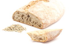 Slice and loaf bread with heap of rye grain Stock Photography