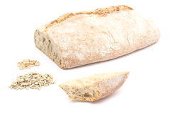 Slice, loaf bread with heap of rye and wheat grain Stock Photo