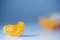Slice of mandarin orange - citrus fruit macro Royalty Free Stock Images