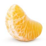 Slice of mandarin orange fruit (tangerine) isolated on white. Slice of mandarin orange (tangerine) - citrus fruit isolated on white with clipping path Royalty Free Stock Image