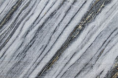 Slice the marble in the rock. Grey marble. Ancient Marble quarry, marble rocks in the wild. The natural stone. Ancient faults Memra Imperial times. Slices of Royalty Free Stock Images