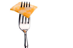 A slice of marbled cheese on a silver fork Royalty Free Stock Photography