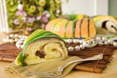 Slice of Mardi Gras King Cake stock images