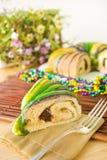 Slice of Mardi Gras King Cake royalty free stock photos