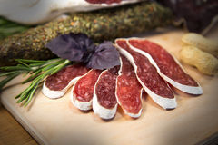 Slice of meat with basil. French meat sliced with peanuts royalty free stock images