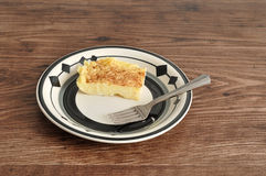 A slice of milk tart with a cake fork Royalty Free Stock Images