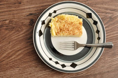 A slice of milk tart with a cake fork Stock Photos