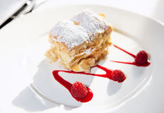Slice of mille-feuille cake on porcelain plate Royalty Free Stock Photos