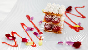 Slice of mille-feuille cake with raspberries Stock Photo