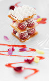 Slice of mille-feuille cake with raspberries Stock Photography