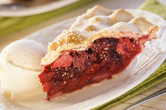 Slice of Mixed Berry Pie with Ice Cream Stock Photography