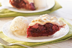 Slice of Mixed Berry Pie with Ice Cream stock images