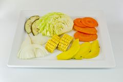 Slice Mixed vegetables  on white dish isolate Royalty Free Stock Photos