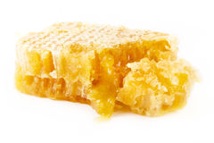 Slice of natural honeycomb over white Stock Image