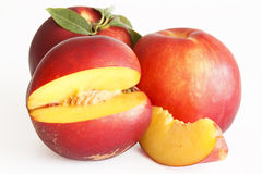 A slice of nectarine. On withe background stock photography