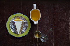 Slice of new york style cheesecake with tea Stock Photography