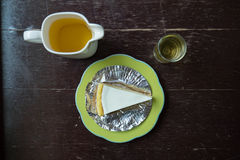Slice of new york style cheesecake with tea Stock Images
