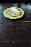 Slice of new york style cheesecake with tea Stock Photo