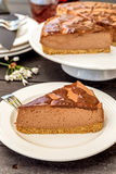 Slice of nutella cheesecake. Slice of homemade nutella cheesecake with chocolate topping Royalty Free Stock Photo