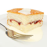 Slice Of Cake And Cream With A Fork Royalty Free Stock Photos