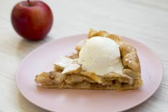 Free Slice Of Home-baked Apple Pie With Icecream On Pink Plate Over White Wooden Background, Side View Royalty Free Stock Images - 128863589