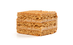 Slice Of Layered Honey Cake Royalty Free Stock Photos