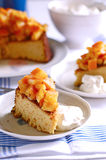 A slice of orange almond cake. A a slice of almond sponge cake with orange compote and whipped cream Royalty Free Stock Image
