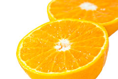 Slice of orange isolated Royalty Free Stock Photos