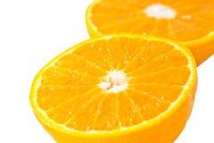 Slice of orange isolated Royalty Free Stock Photos