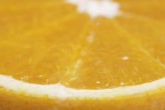 Slice of orange macro closeup Royalty Free Stock Photos