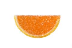 Slice Of Orange Marmalade On A White Background. Slice of orange marmalade sprinkled with granulated sugar on a white background Royalty Free Stock Photos