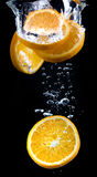 Slice of orange in the water with bubbles Stock Image